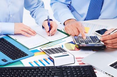 bigstock-Hand-with-calculator-Finance-49662425
